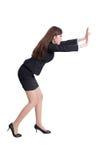 Serious business woman push something Royalty Free Stock Image
