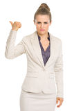 Serious business woman showing get out gesture Stock Photography