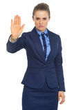 Serious business woman showing stop gesture Royalty Free Stock Image