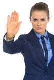 Serious business woman showing stop gesture Stock Photos