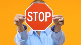 Serious business woman showing stop sign into camera, sexual harassment on work stock footage