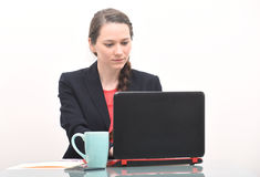 Serious business woman typing on computer Royalty Free Stock Photos