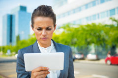 Serious business woman using tablet pc in office Stock Images