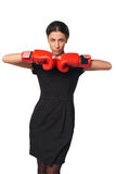 Serious business woman wearing boxing gloves Stock Image