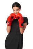 Serious business woman wearing boxing gloves royalty free stock photo
