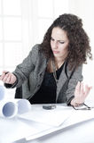 Serious business woman at work Royalty Free Stock Photos