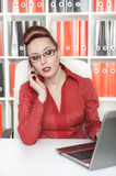 Serious business woman workin Royalty Free Stock Images