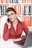 Serious business woman working Stock Photos