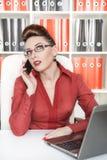 Serious business woman working Stock Photos