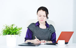 Serious business woman writing Stock Image