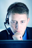 Serious businessman. With hands free at the computer Stock Images