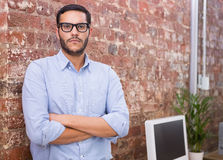 Serious businessman with arms crossed at office Stock Image