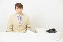 Serious businessman attentively listens Stock Photo
