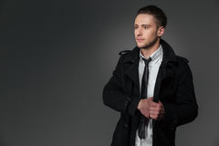 Serious businessman in black coat, white shirt and tie Stock Photography