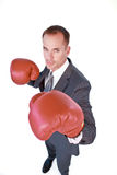 Serious businessman boxing. High angle of serious businessman boxing against white background royalty free stock image