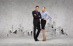 Serious businessman and businesswoman Stock Images