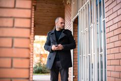 Serious businessman with cell phone royalty free stock photos