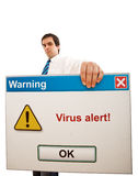 Serious businessman with computer virus alert Stock Image