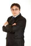 Serious businessman with crossed arms on chest Stock Photo