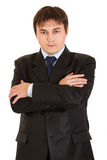 Serious businessman with crossed arms on chest Stock Image