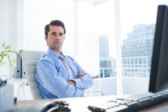 Serious businessman crosses his arms Stock Photo