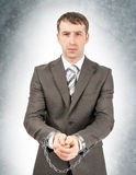Serious businessman in cuffs Royalty Free Stock Photo