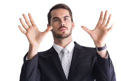 Serious businessman with finger spread out Stock Images