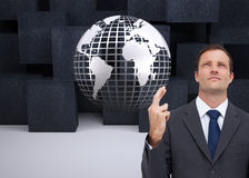 Serious businessman with fingers crossed is looking up Royalty Free Stock Image