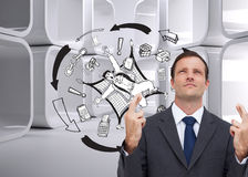 Serious businessman with fingers crossed is looking up Royalty Free Stock Images