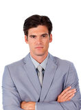 Serious businessman with folded arms Stock Images