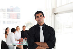 Serious Businessman with folded arms Stock Photos