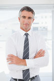 Serious businessman with folded arms Royalty Free Stock Image