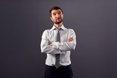Man with folded hands looking up Royalty Free Stock Images