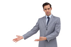 Serious businessman giving a presentation with his hands Stock Image