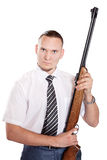 Serious Businessman with gun. Serious Businessman holding gun at white background Stock Image