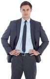 Serious businessman with hands on hips Royalty Free Stock Photos