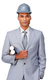 Serious businessman with hard hat and blueprints royalty free stock photo