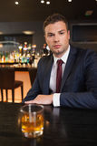 Serious businessman having a drink Royalty Free Stock Images