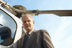 Serious Businessman By Helicopter Royalty Free Stock Photography