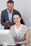 Serious businessman helping his colleague Stock Photography