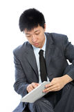 Serious businessman with his tablet Stock Photography