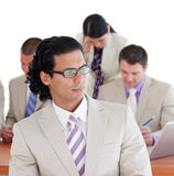 Serious businessman with his team Stock Photography