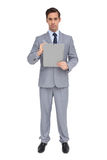 Serious businessman holding a clipboard Stock Photo