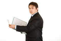 Serious businessman holding folder with documents royalty free stock images