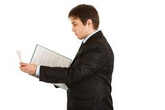 Serious businessman holding folder with documents Stock Photography
