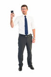 Serious businessman holding his phone Stock Photo