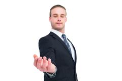 Serious businessman holding out his hand Royalty Free Stock Photos