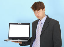 Serious businessman holds on hand laptop Royalty Free Stock Photography