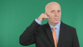Serious Businessman Make Call Me Hand Gestures stock photo