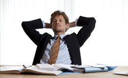 Serious businessman leaning back Stock Photography